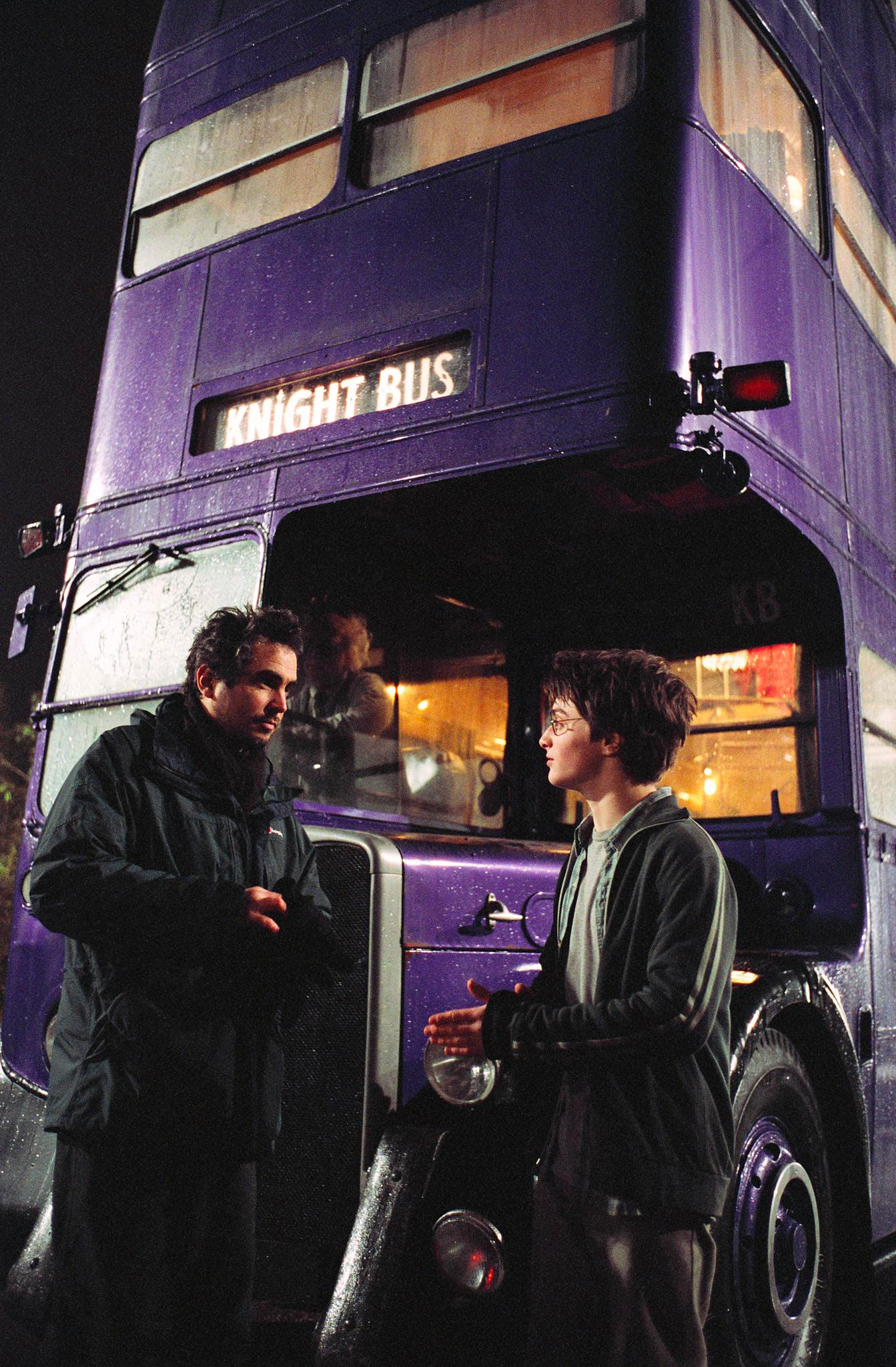 Alfonso Cuarón and Dan Radcliffe in front of the Knight Bus