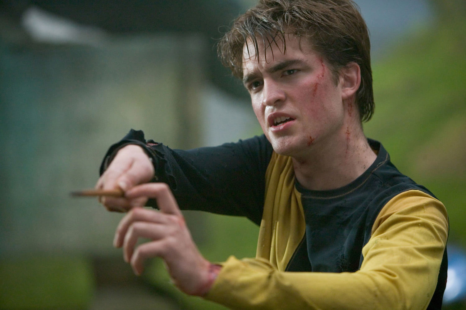 Cedric with wand raised