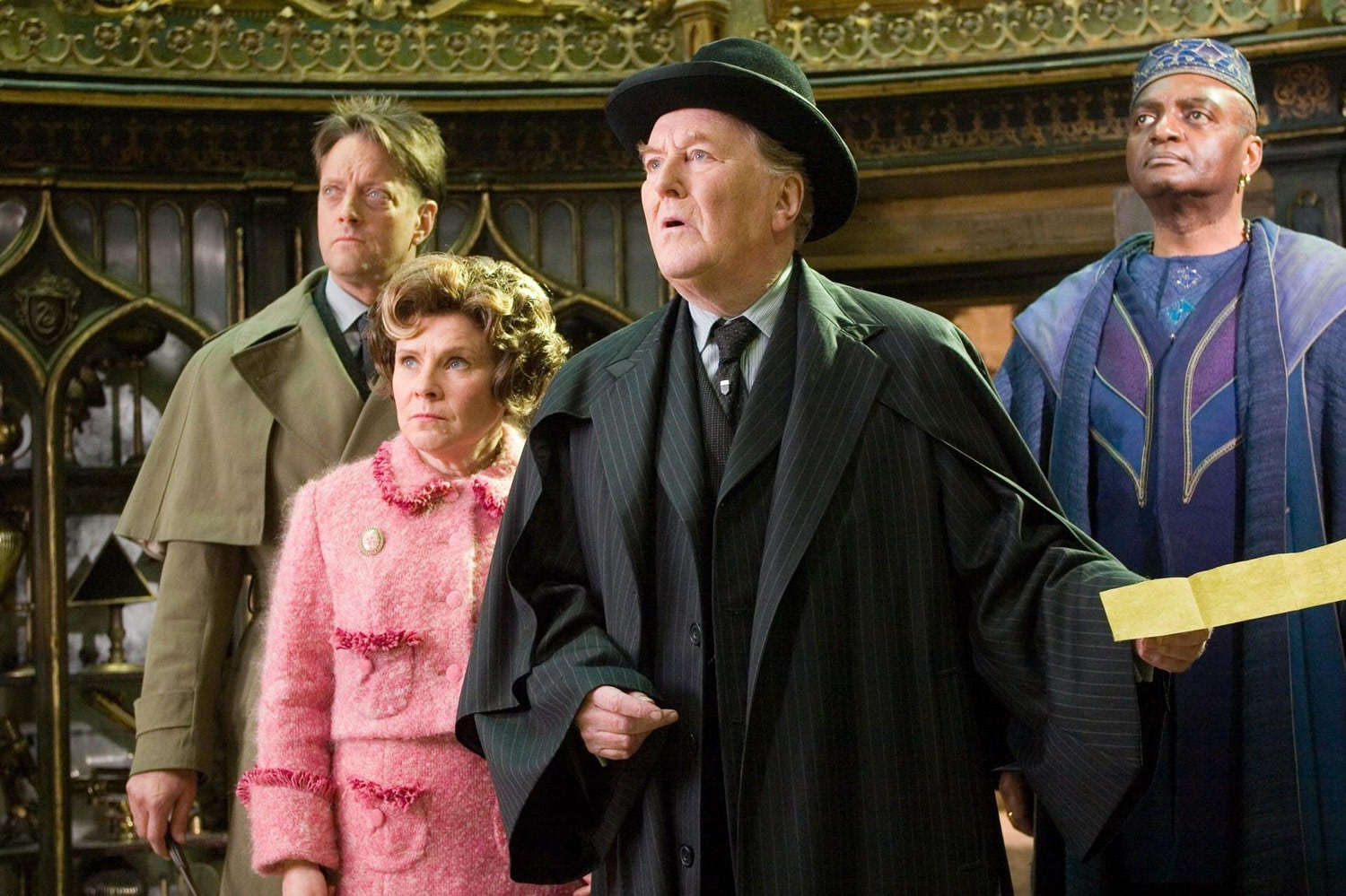 Dawlish, Umbridge, Fudge and Shacklebolt in Dumbledore's office