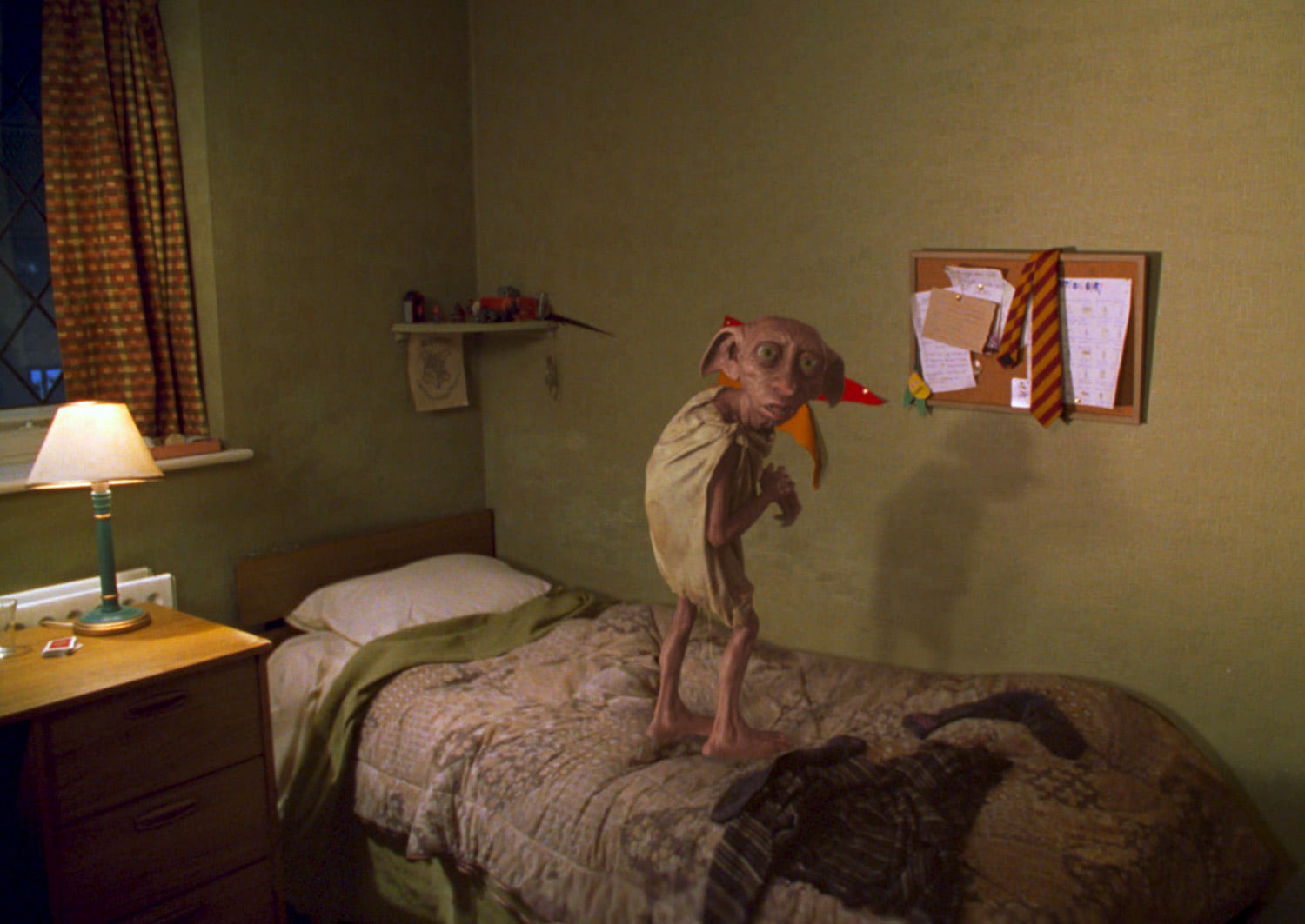 Dobby jumps on Harry's bed
