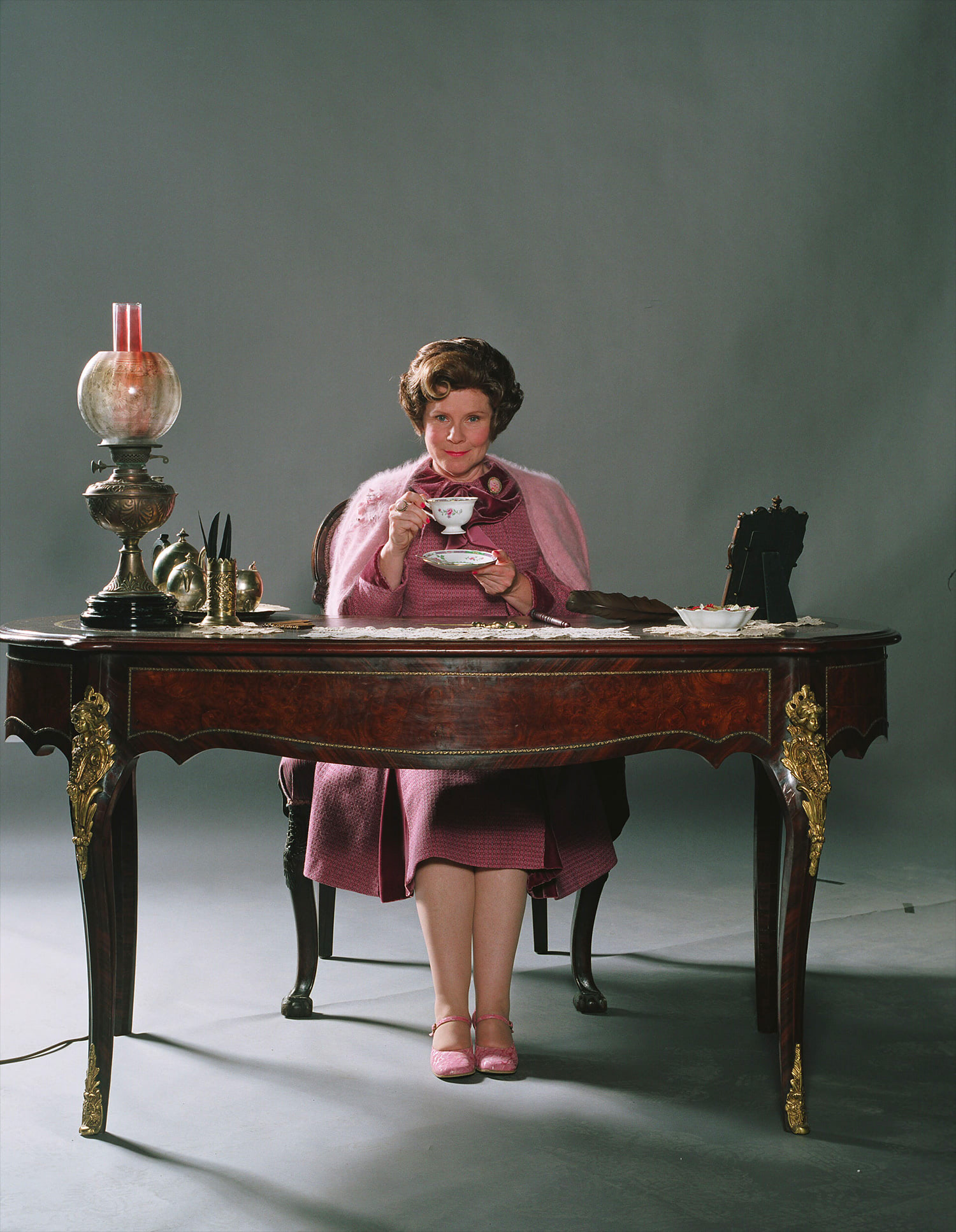 Portrait of Dolores Umbridge at her desk