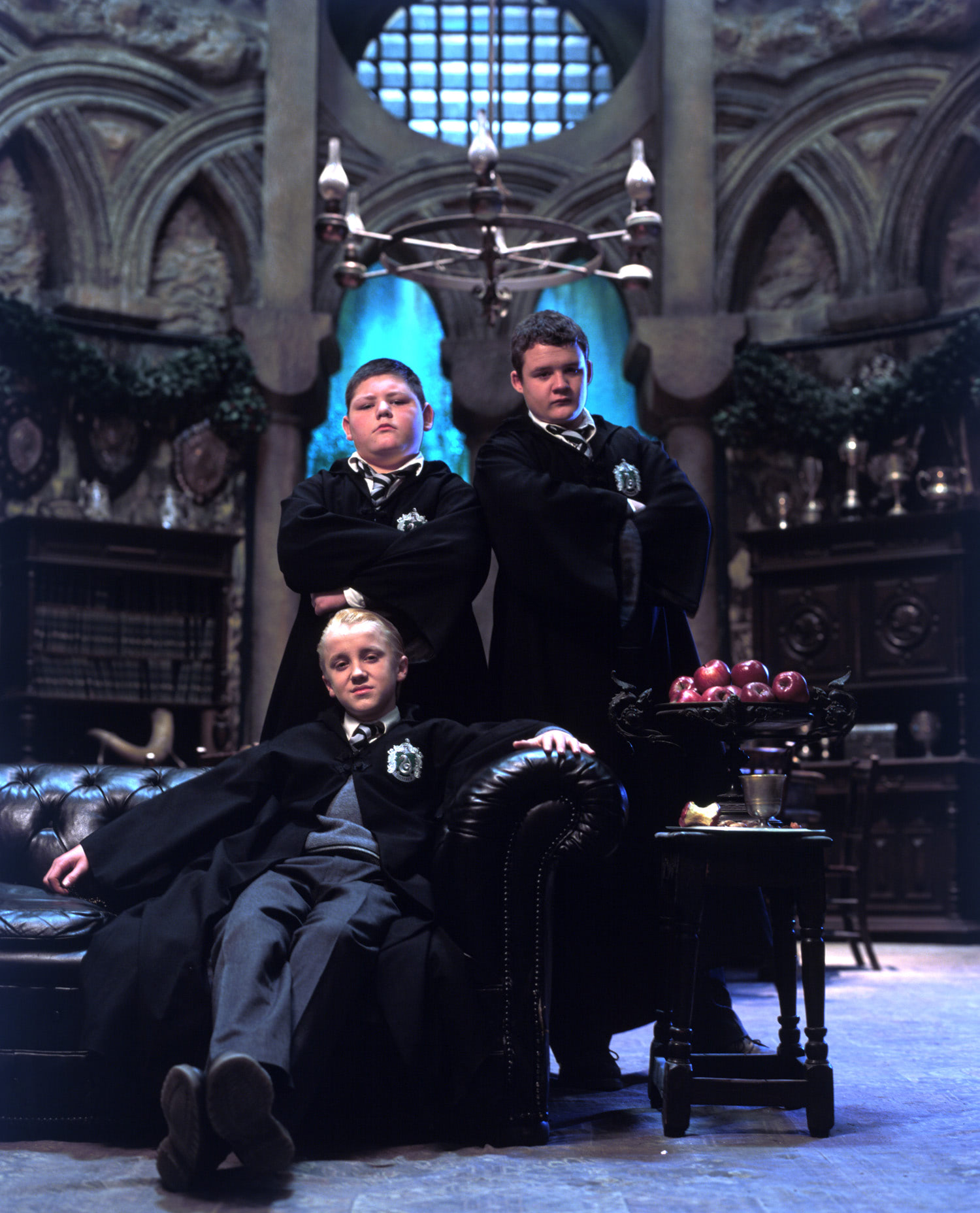 Draco, Crabbe and Goyle in the Slytherin Common Room