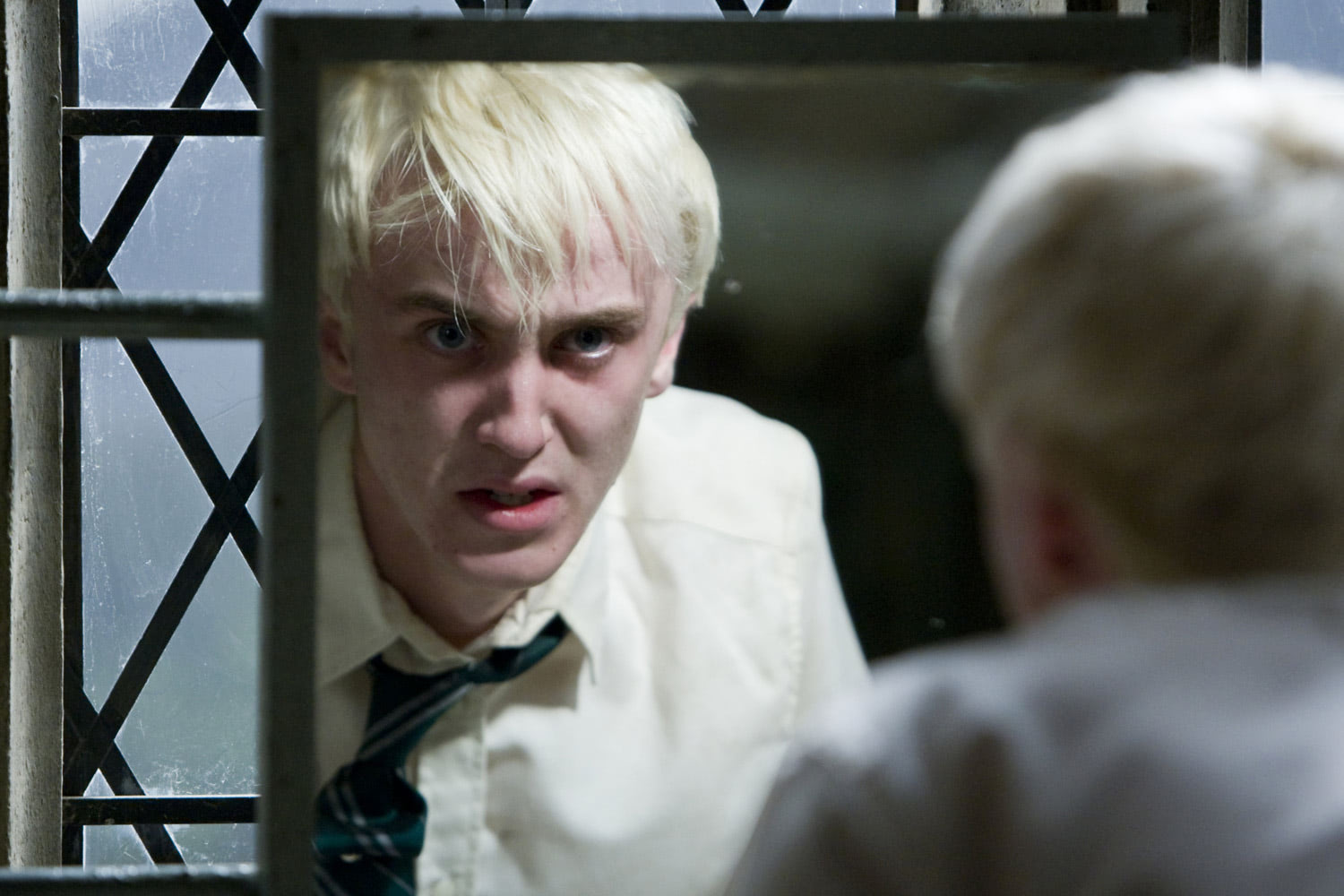Draco Malfoy looks in the mirror