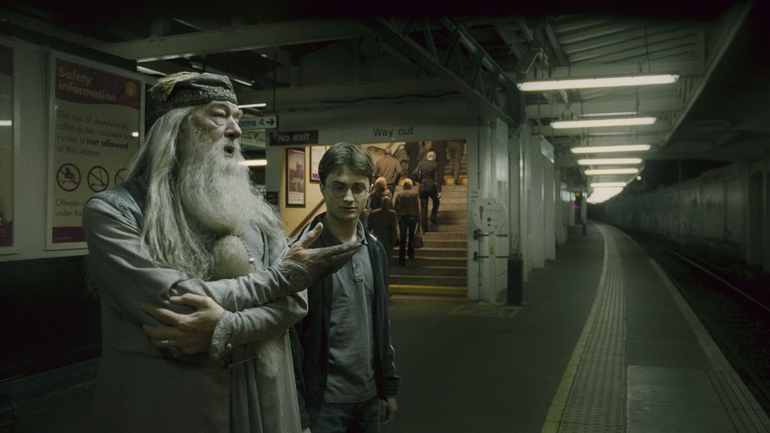 Dumbledore and Harry at the train station