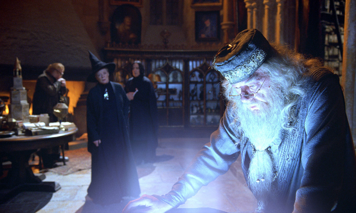 Dumbledore looks into the Pensieve