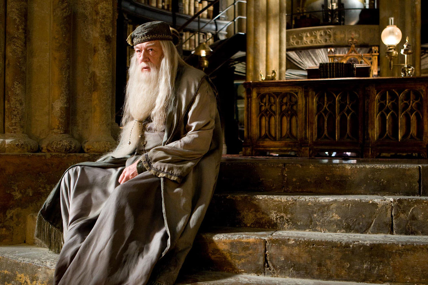 Dumbledore sits on the steps