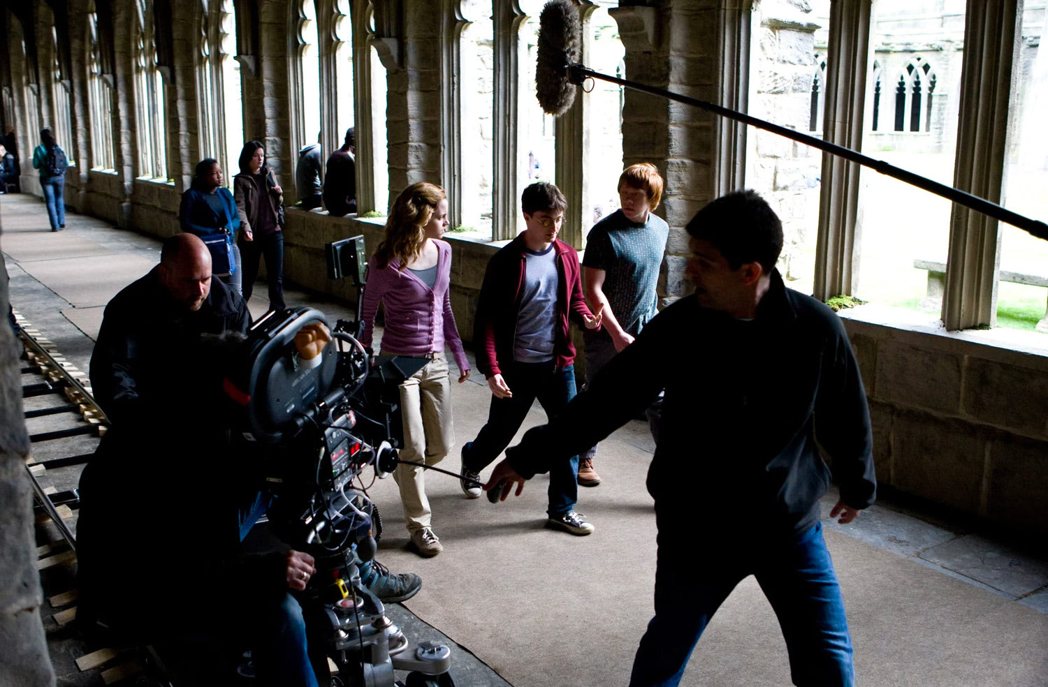 Emma, Dan and Rupert filming in a corridor