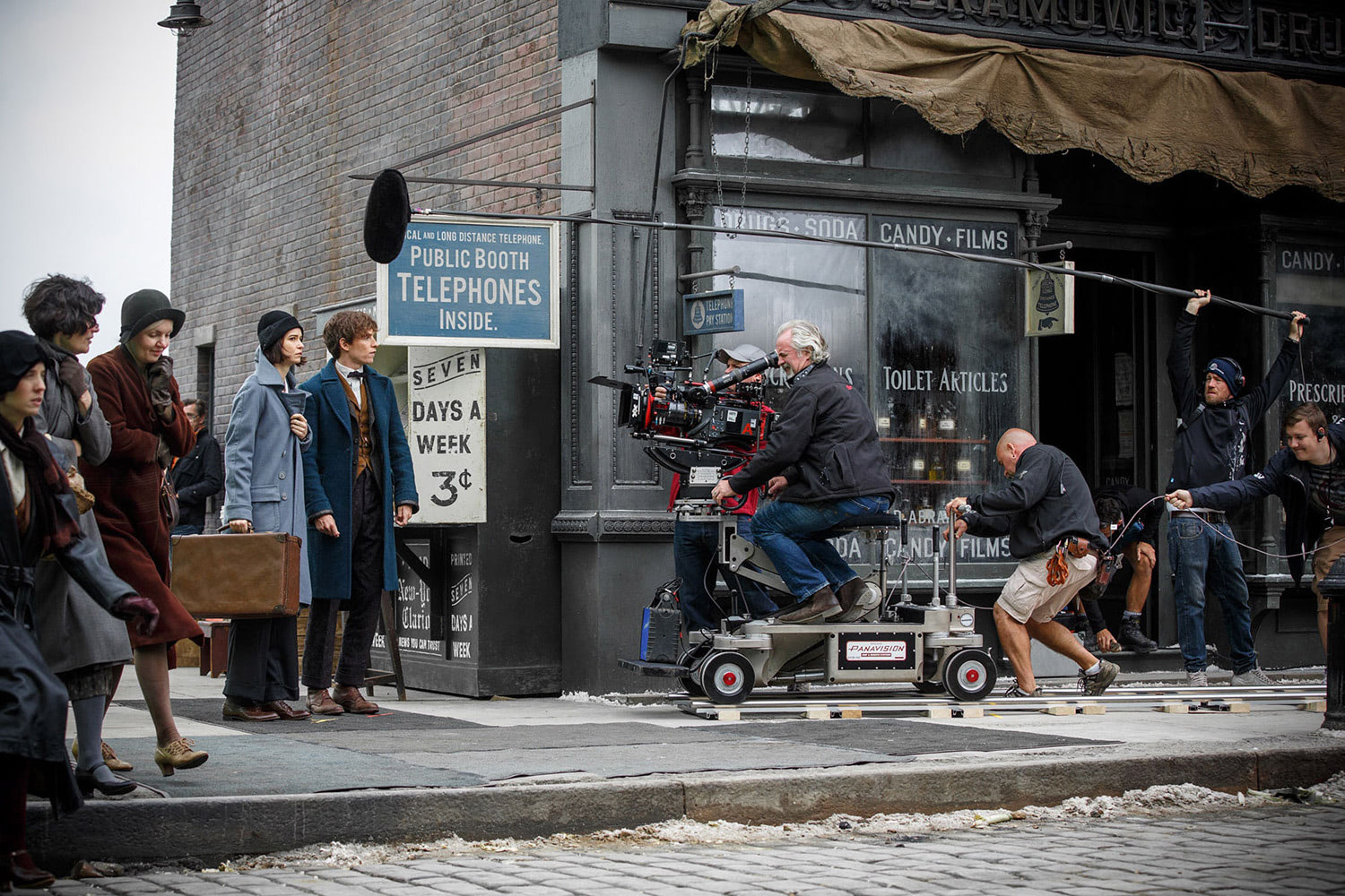 Eddie Redmayne and Katherine Waterston film a street scene