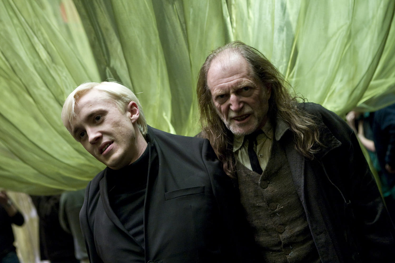 Filch catches Draco at Slughorn's party