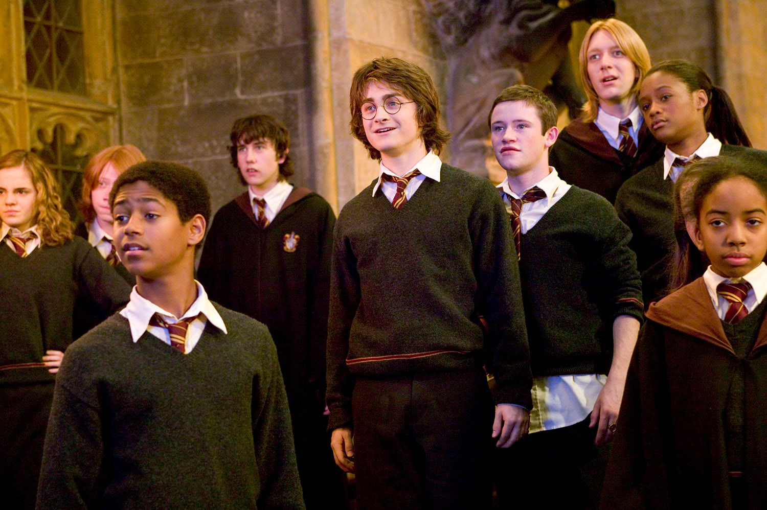 Gryffindor students watch the Goblet of Fire