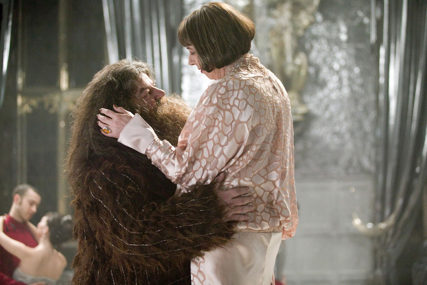 Hagrid and Madame Maxime embrace