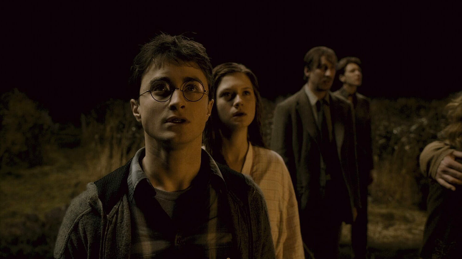 Harry and Ginny watch The Burrow burn