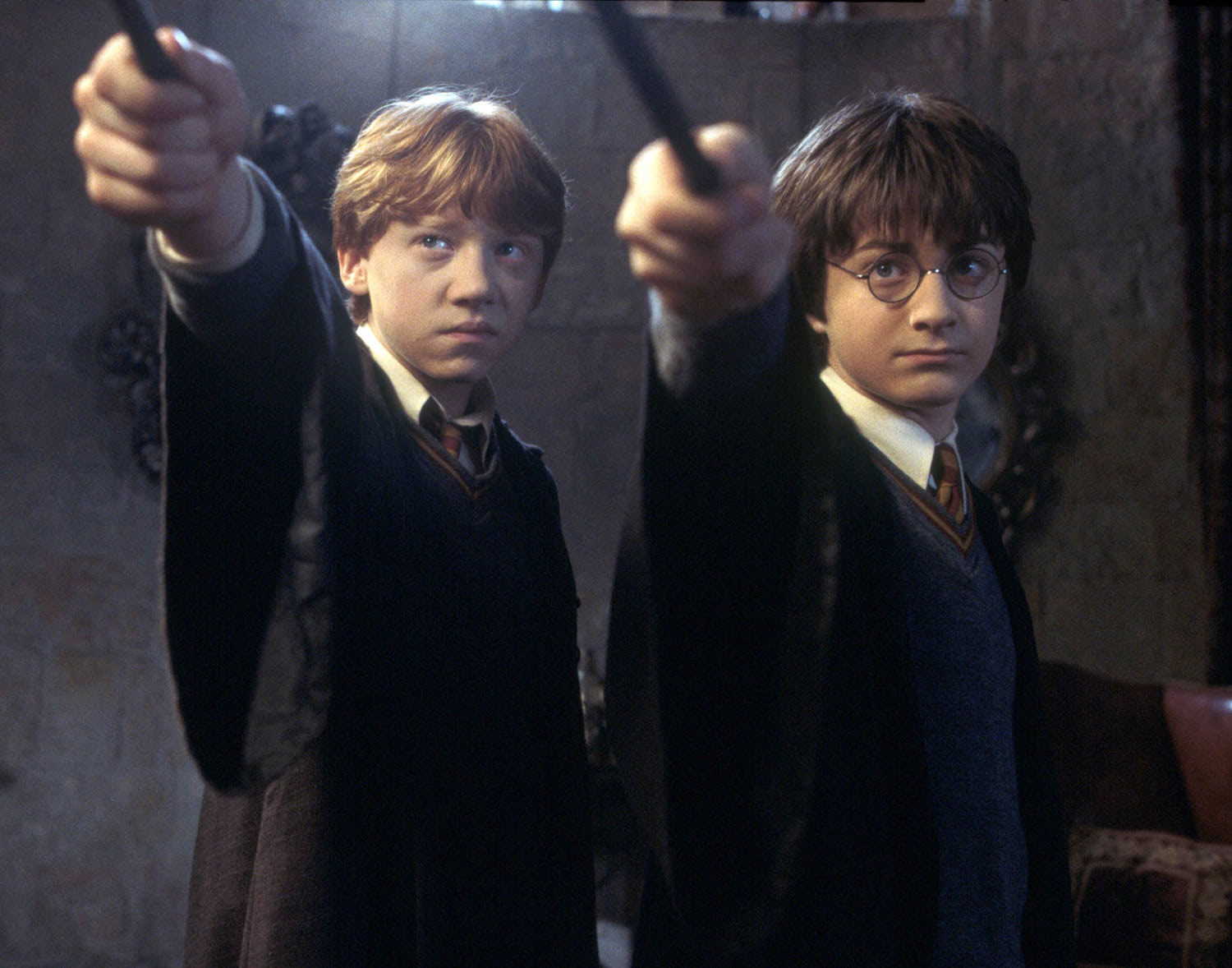 Harry and Ron with wands at the ready