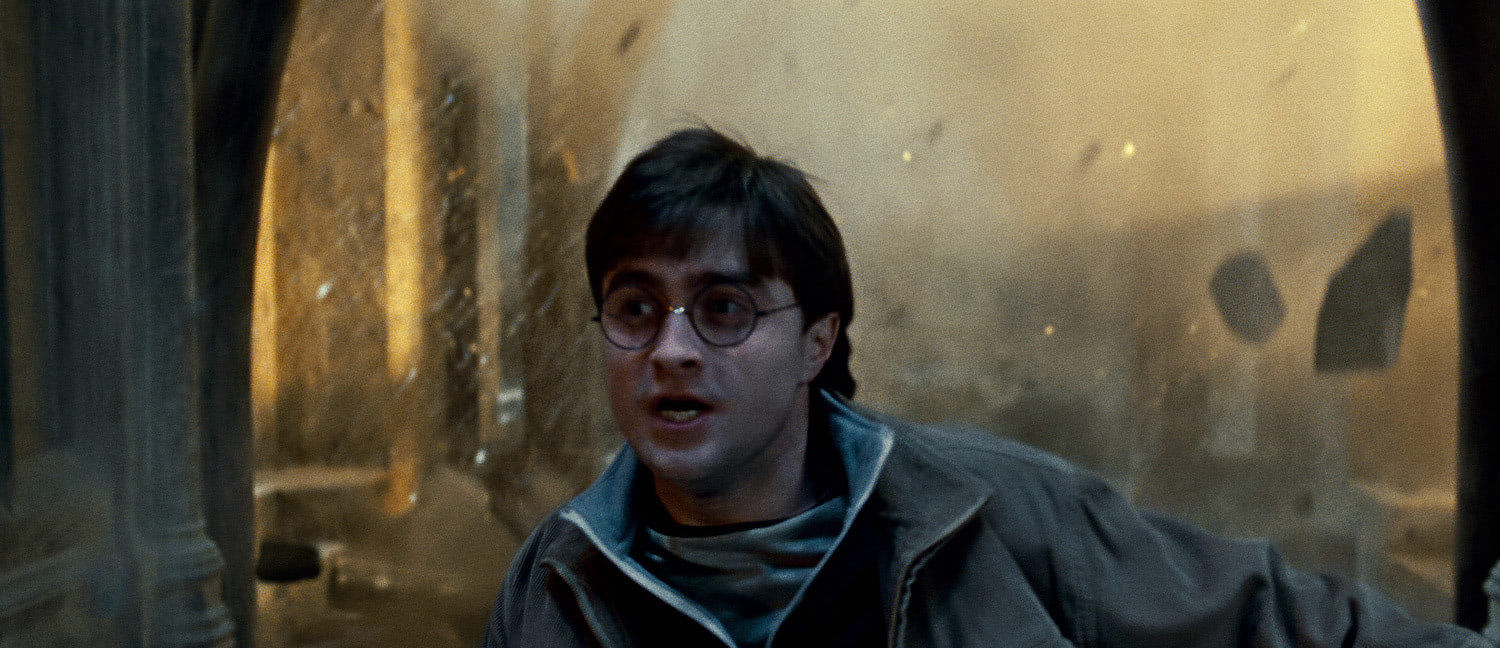 Harry escapes falling rubble