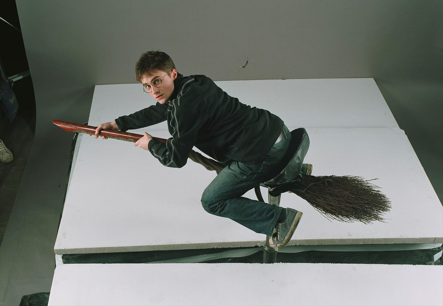 Portrait of Harry Potter riding his broom