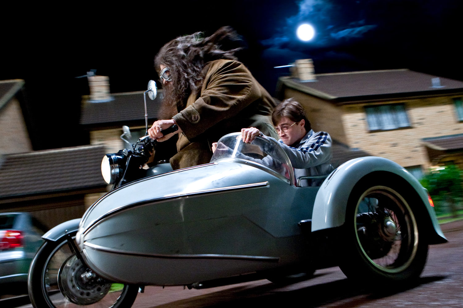Harry rides in Hagrid's sidecar