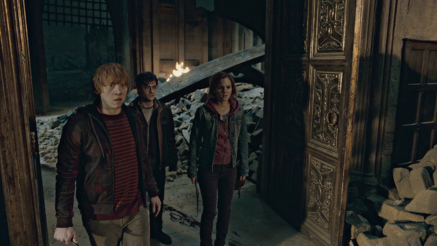 Harry, Ron and Hermione amongst destruction