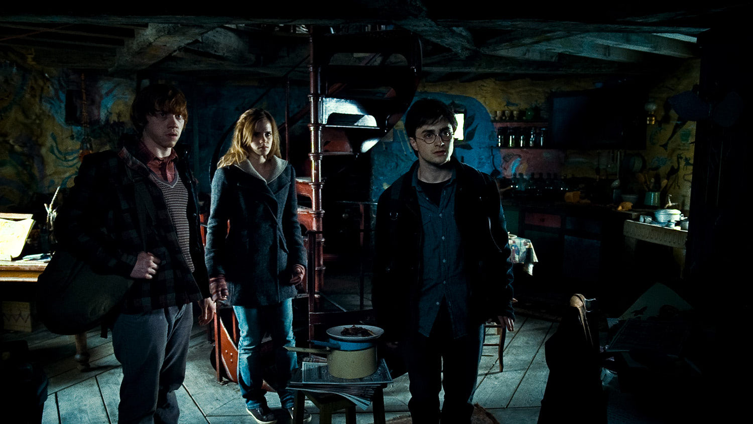 Harry, Ron and Hermione at the Lovegood house