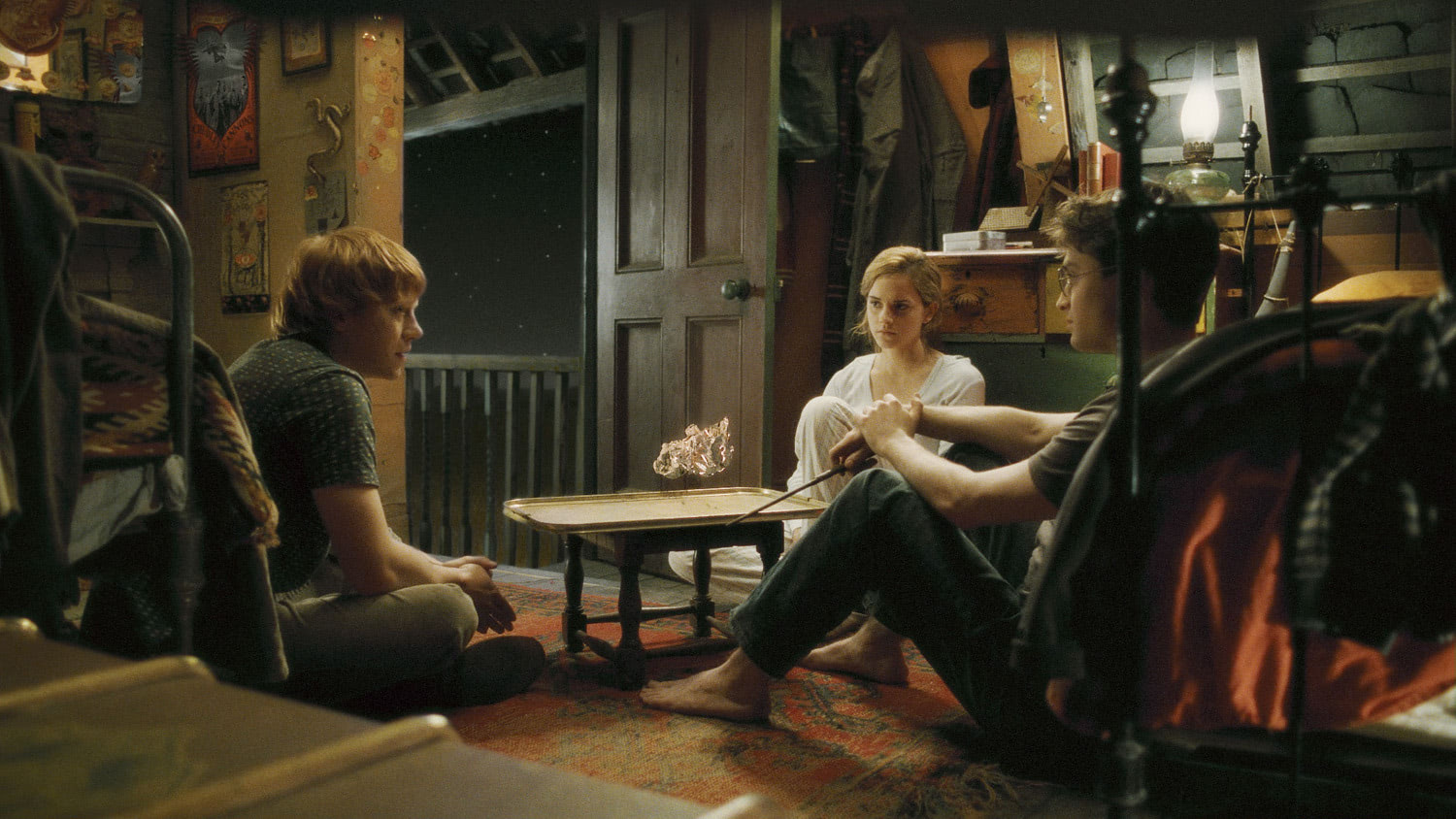 Ron, Hermione and Harry talking at The Burrow