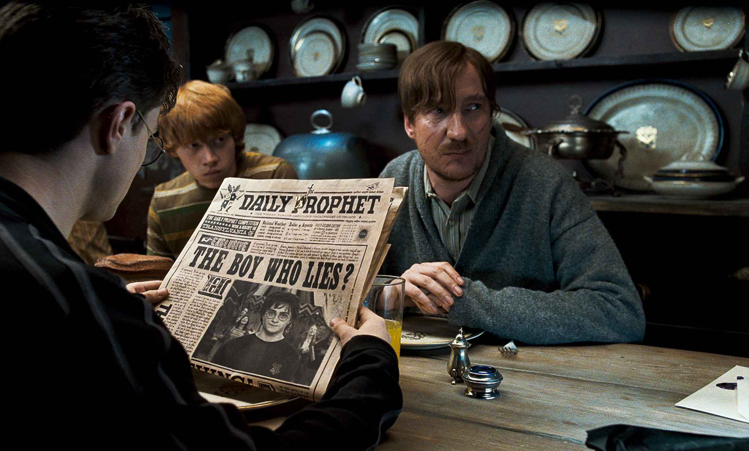 Harry, Ron and Lupin at Grimmauld Place