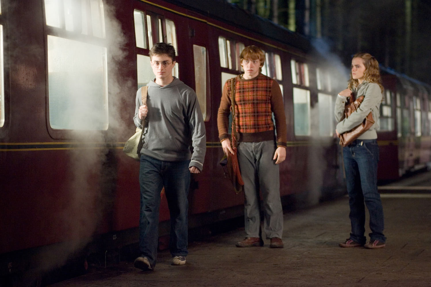 Harry, Ron and Hermione by the Hogwarts Express