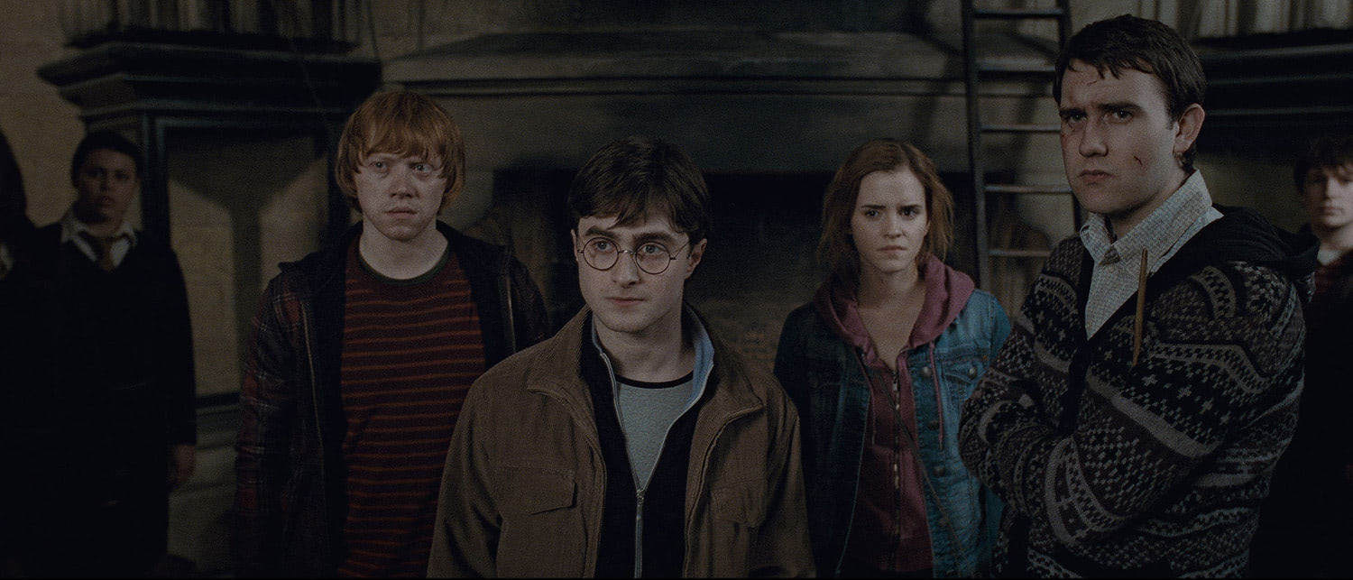 Harry, Ron, Hermione and Neville in the Room of Requirement