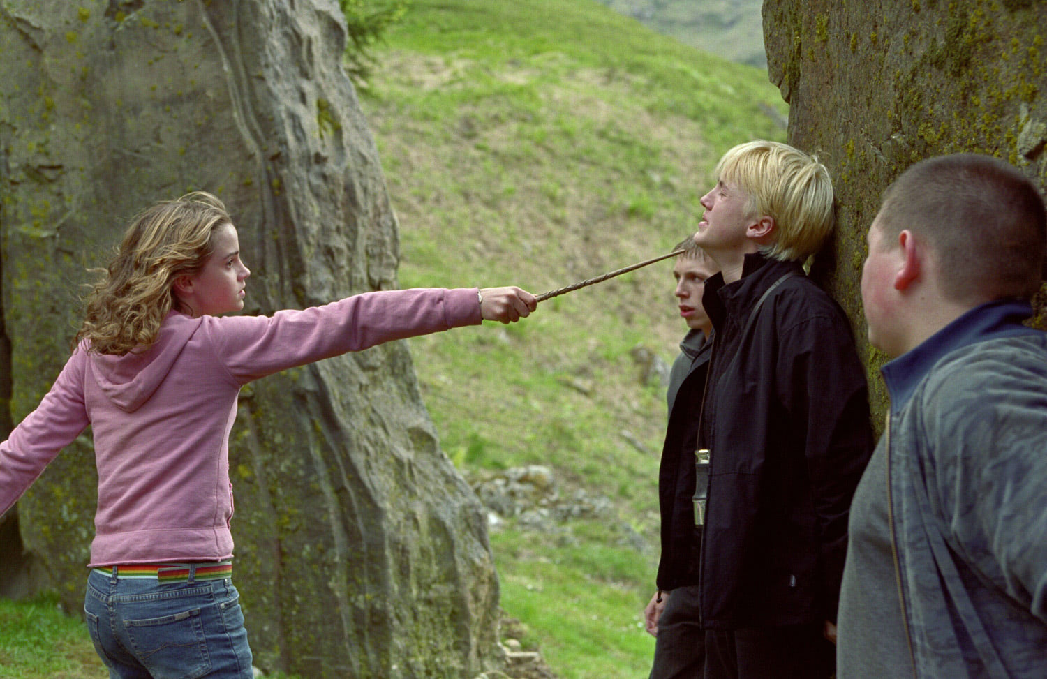 Hermione with wand pointed at Draco