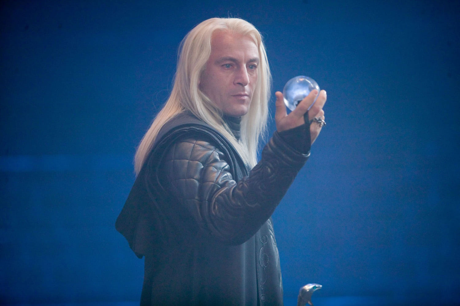 Lucius Malfoy with the prophecy