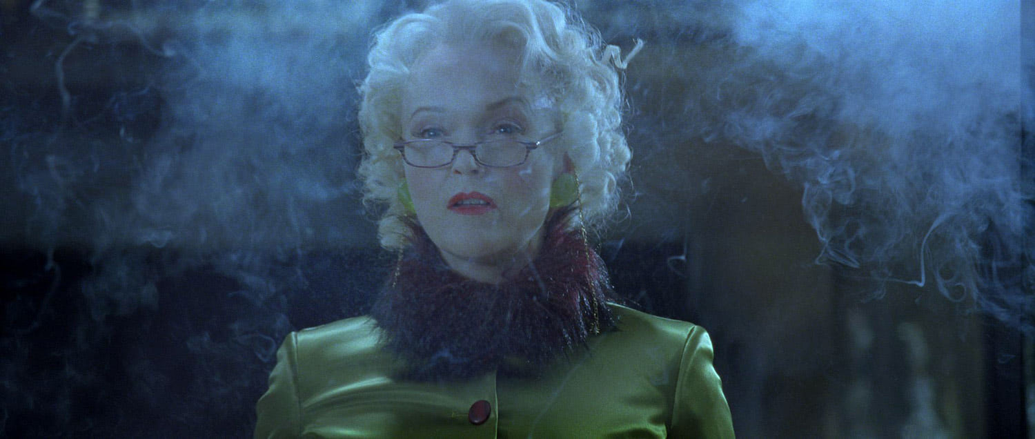 Rita Skeeter clouded in smoke
