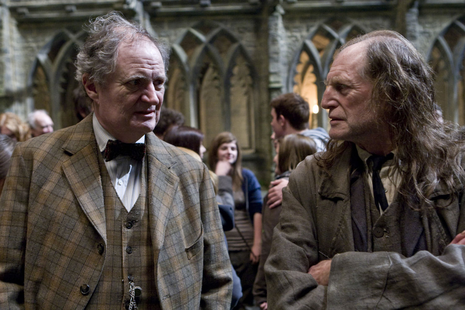 Slughorn and Filch in the grounds
