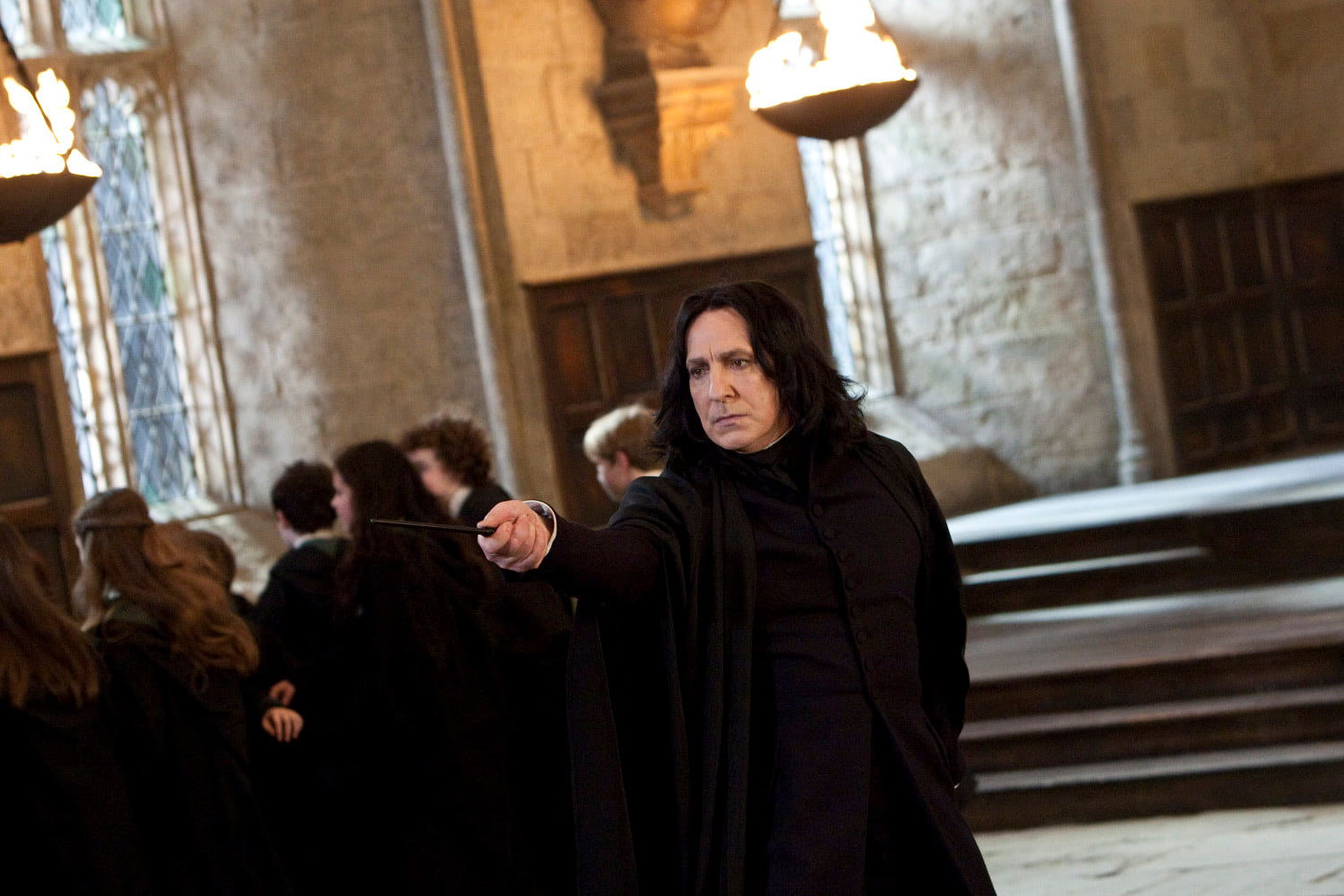 Snape holds his wand in the Great Hall