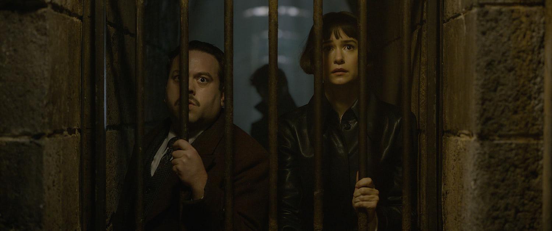 Tina and Jacob behind bars