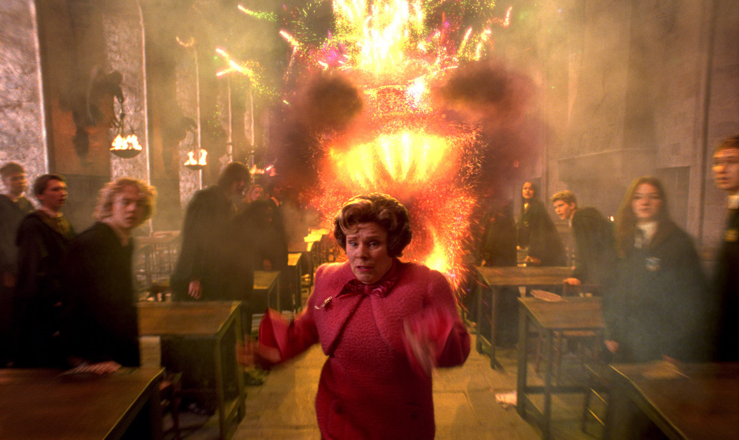 Umbridge runs from the fire dragon