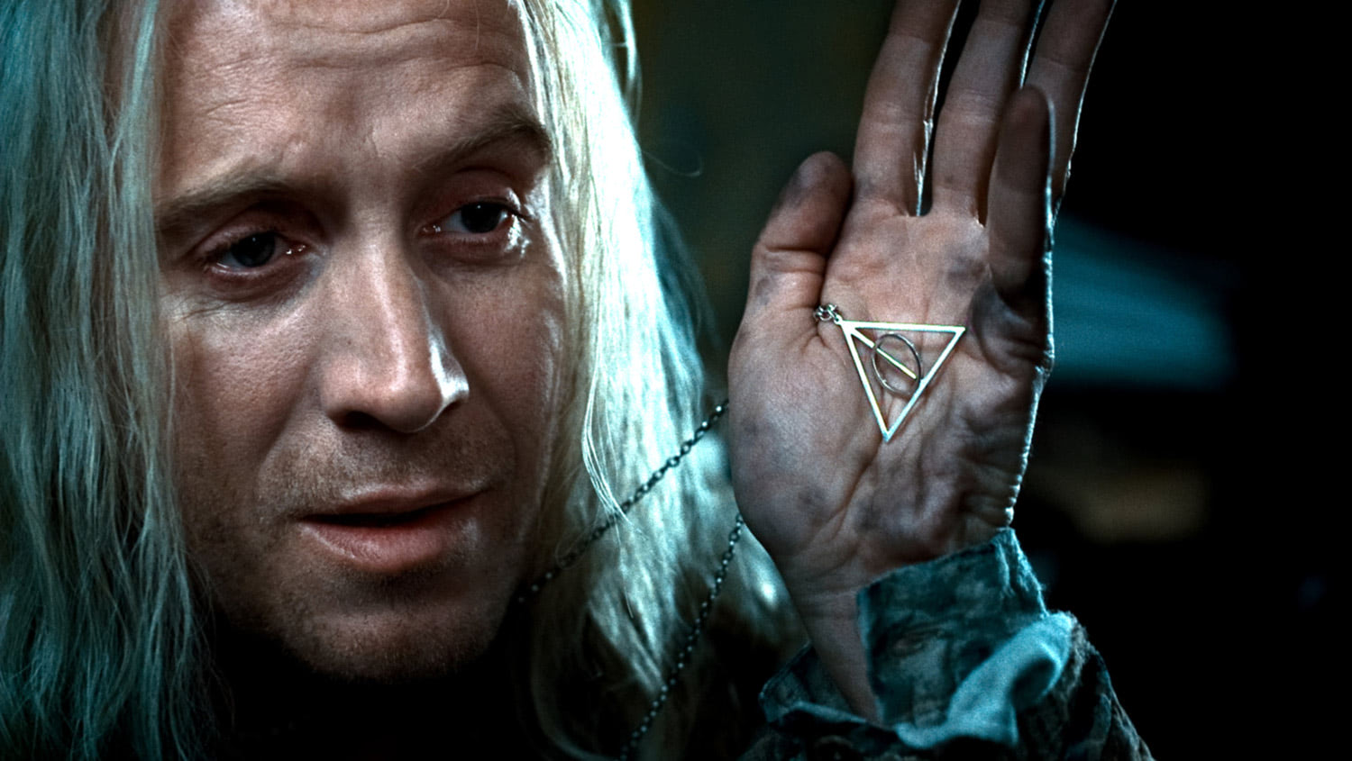 Xenophilius Lovegood with the Deathly Hallows necklace